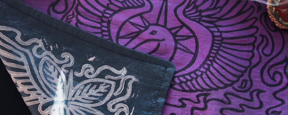 Phoenix Altar Cloth Benu Ibis Phoenix with Myrrh, Cinnamon and a Sun Beam Halo in reference to Greek Titan Helios - Purple Taffeta Cloth showing Petrol Blue Taffeta Reverse Side - Hand Printed with Hand Carved Lino Stamp