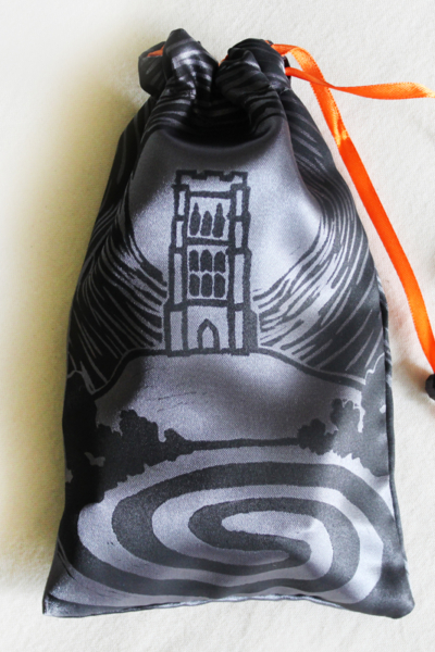 Glastonbury Tor Pouch, Mystical Avalon Tower on Hill with Glastonbury Spiral White Spring - Dark Grey Satin Pouch with Orange Details - Hand Printed with Hand Carved Lino Stamp