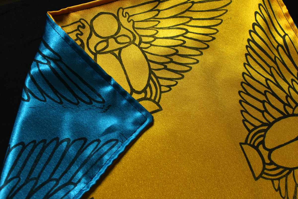 Scarab Altar Cloth Winged Scarab God Khepri with Sun Disc - Yellow Satin Altar Cloth showing Turquoise Satin Reversible Side - Hand Printed with Hand Carved Lino Stamp