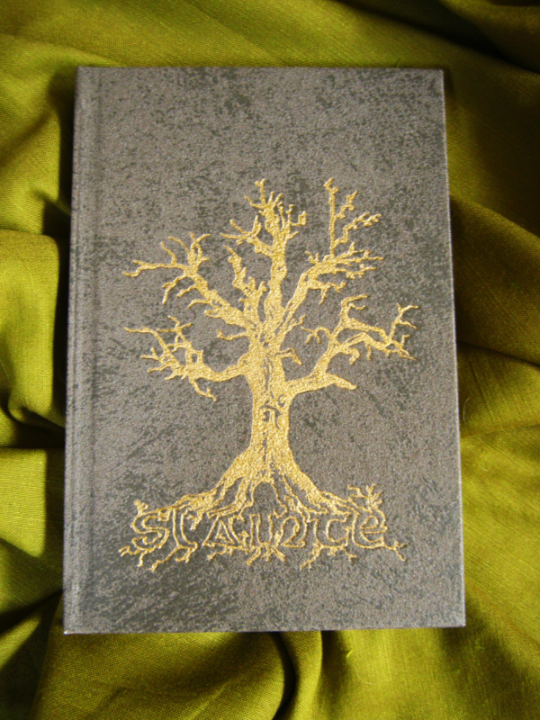 Sláinte - A Hand Printed and Hand Bound Book of Traditional British Folk Songs created using Metal Moveable Type and Stereotype Plates/Cliché Plates - Tree Cover Design - Bookmaking by Imogen Smid and Anouk Essers