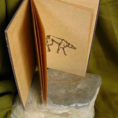 Sláinte - A Hand Printed and Hand Bound Book of Traditional British Folk Songs created using Metal Moveable Type and Stereotype Plates/Cliché Plates - Wolfhound Illustration - Bookmaking by Imogen Smid and Anouk Essers